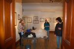 Tring exhibit setup, with Katrina, husband Hein, and helper finishing it up.