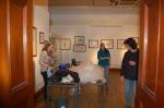Tring exhibit setup, with Katrina, husband Hein, and helper finishing it up.