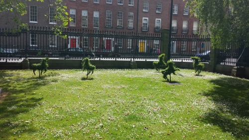 Adorable frolicking topiaries outside the NHM.
