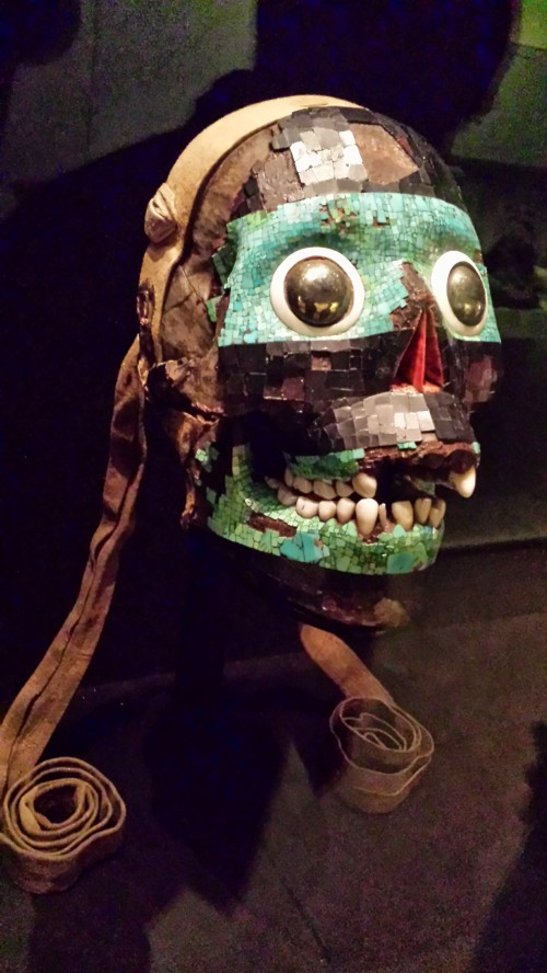 Use of a human skull to make a stunning mask decorated with obsidian, representing Tezcatlipoca, the Smoking Mirror and master of creation/destruction; slayer of Quetzalcoatl. Badass dial turned to 11!